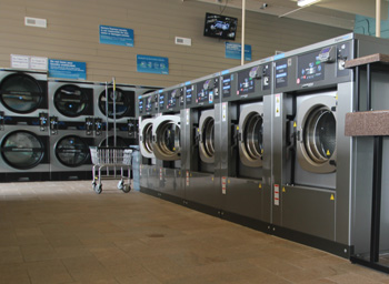 row of high speed washers at seneca express laundry