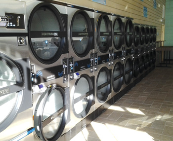 row of high speed dryers at seneca express laundry